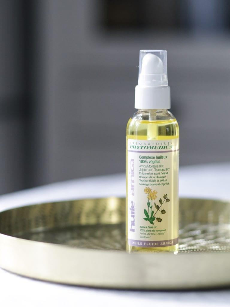 l'huile de massage à l'arnica